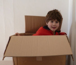Boy getting out of a box